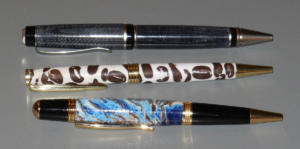 Pens from unusual materials: Layered Blue Jeans (top), Stabilized Coffee Beans (center). ?????? (bottom) by Curt Van Weelden
