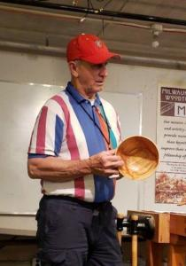 Mel Micky showing bowl turned by his grandaughter.