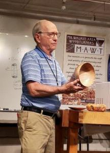Harold Solberg showing turned bowl.